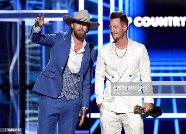 Brian Kelley and Tyler Hubbard of Florida Georgia Line accept the Top Country Song award for 'Meant to Be' onstage during the 2019 Billboard Music...