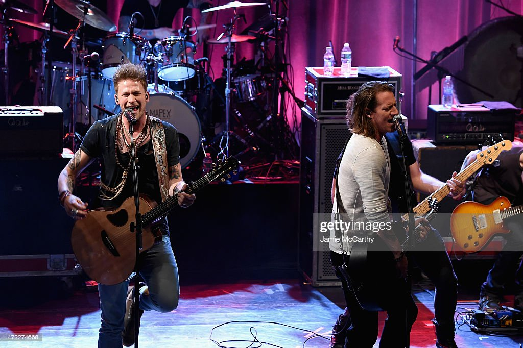 Brian Kelley (L) and Tyler Hubbard of Florida Georgia Line perform onstage as Live Nation Celebrates National Concert Day At Their 2015 Summer Spotlight Event Presented By Hilton at Irving Plaza on May 5, 2015 in New York City.