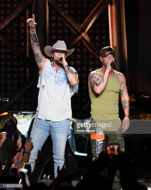 Brian Kelley and Tyler Hubbard of Florida Georgia Line perform onstage at Northwell Health at Jones Beach Theater on July 20 2019 in Wantagh New York