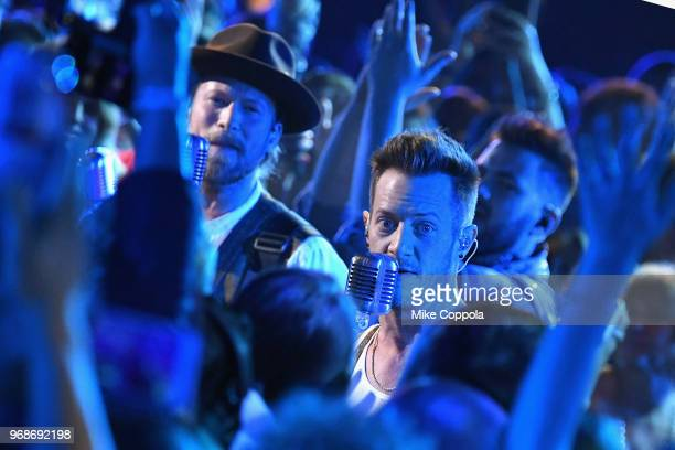 Brian Kelley and Tyler Hubbard of Florida Georgia Line perform onstage at the 2018 CMT Music Awards at Bridgestone Arena on June 6 2018 in Nashville...