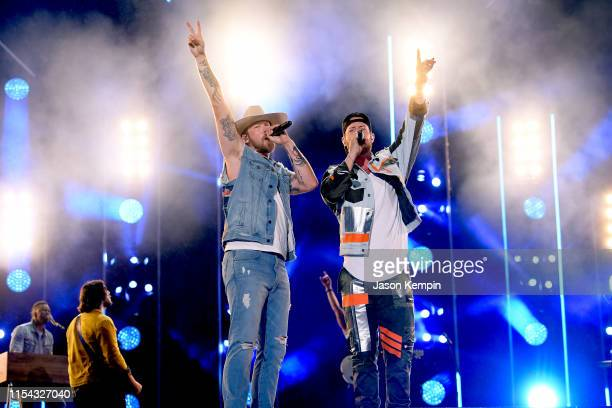 Brian Kelley and Tyler Hubbard of Florida Georgia Line perform on stage during day 1 of 2019 CMA Music Festival on June 06 2019 in Nashville Tennessee