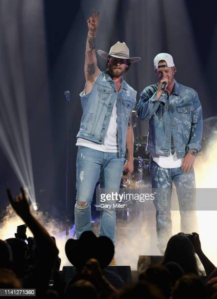 Brian Kelley and Tyler Hubbard of Florida Georgia Line perform onstage during the 2019 iHeartCountry Festival Presented by Capital One at the Frank...