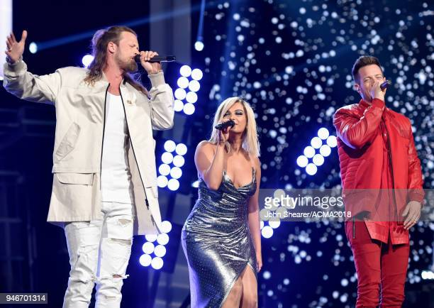 Brian Kelley and Tyler Hubbard of Florida Georgia Line perform onstage with Bebe Rexha during the 53rd Academy of Country Music Awards at MGM Grand...