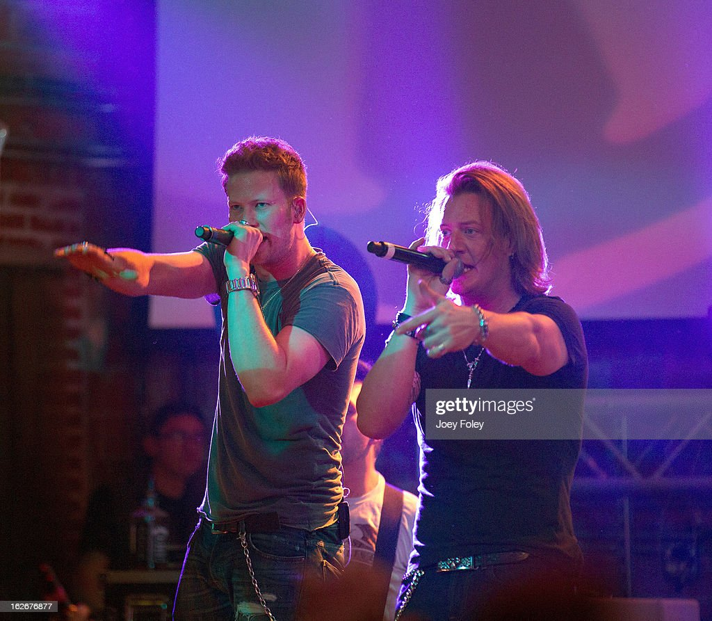 Brian Kelley and Tyler Hubbard of Florida Georgia Line performs at Brick Street Bar on February 20, 2013 in Oxford, Ohio.