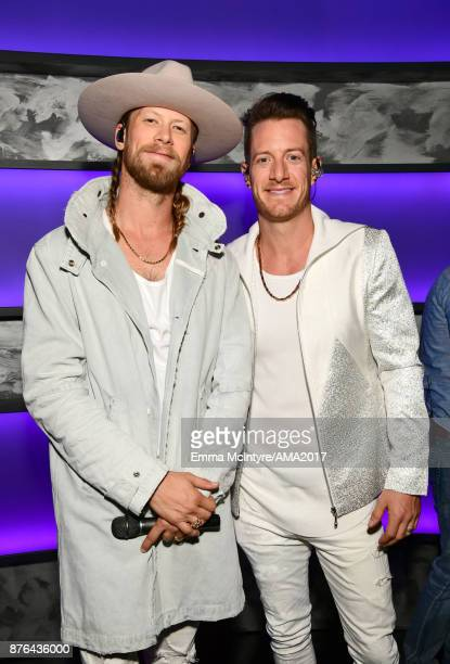 Brian Kelley and Tyler Hubbard of Florida Georgia Line pose backstage during the 2017 American Music Awards at Microsoft Theater on November 19 2017...