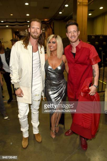 Brian Kelley and Tyler Hubbard of Florida Georgia Line pose backstage with Bebe Rexha during the 53rd Academy of Country Music Awards at MGM Grand...