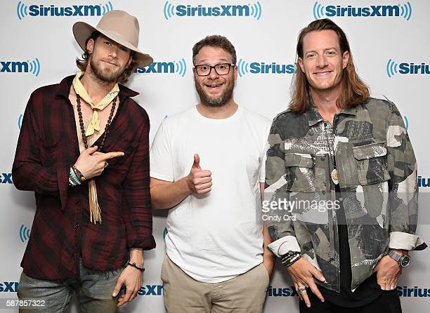 Brian Kelley and Tyler Hubbard of Florida Georgia Line pose for a photo with actor Seth Rogen during their visit to the SiriusXM Studios on August 8...