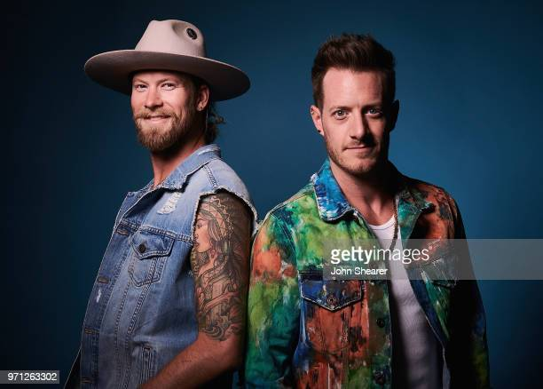 Brian Kelley and Tyler Hubbard of Florida Georgia Line pose in the portrait studio at the 2018 CMA Music Festival at Nissan Stadium on June 10 2018...