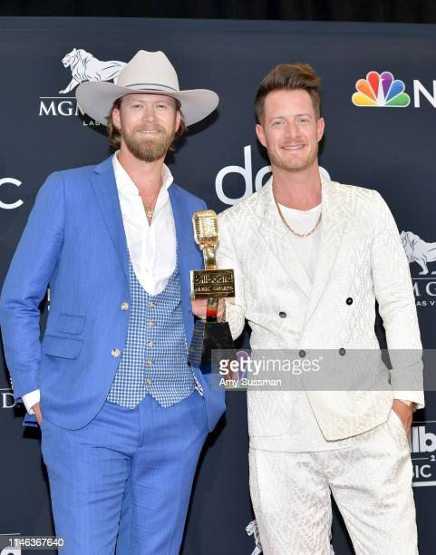 Brian Kelley and Tyler Hubbard of Florida Georgia Line pose with the award for Top Country Song for 'Meant to Be' in the press room during the 2019...