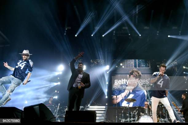 Brian Kelley and Tyler Hubbard of multiplatinum superstar duo Florida Georgia Line perform onstage to with Titans head coach Mike Vrabel during The...