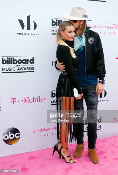 Brian Kelley of Florida Georgia Line and Brittney Cole Kelley arrive at the 2017 Billboard Music Awards presented by Virginia Black at TMobile Arena...
