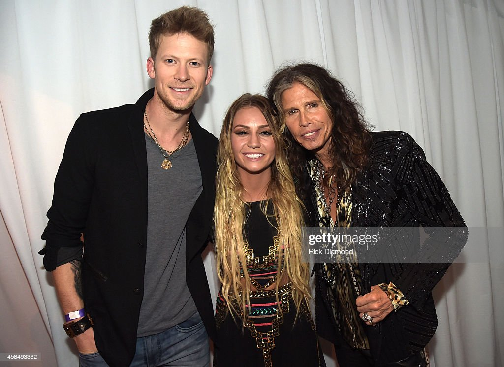 Brian Kelley of Florida Georgia Line, Brittney Marie Cole, and Steven Tyler attend the Big Machine Label Group Celebrates The 48th Annual CMA Awards in Nashville on November 5, 2014 in Nashville, Tennessee.