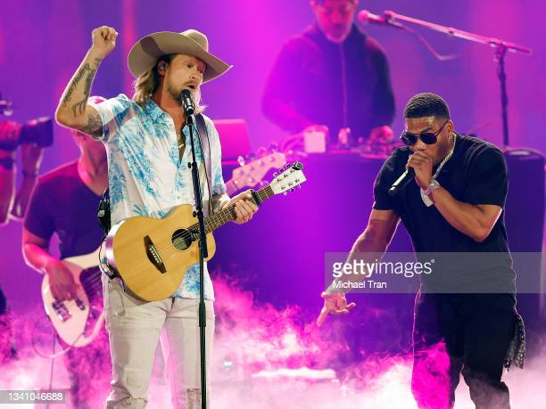 Brian Kelley of Florida Georgia Line perform with Nelly onstage during the 2021 iHeartRadio Music Festival - Night One held at T-Mobile Arena on...