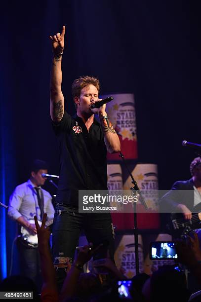 Brian Kelley of Florida Georgia Line performs during the 9th annual Stars For Second Harvest Benefit at Ryman Auditorium on June 3, 2014 in...