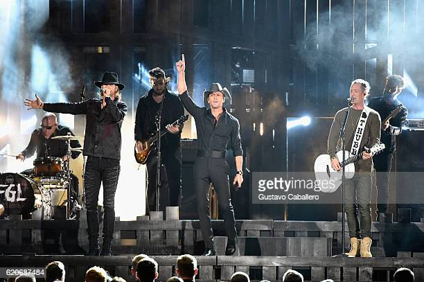 Brian Kelley Tim McGraw and Tyler Hubbard perform onstage at the 50th annual CMA Awards at the Bridgestone Arena on November 2 2016 in Nashville...