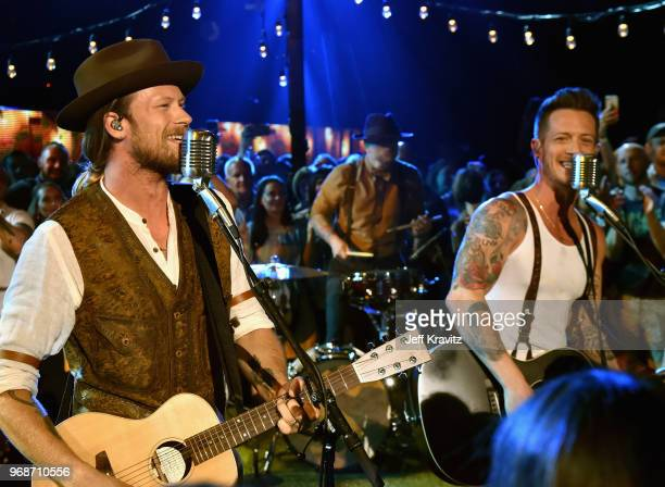 Brian Kelley Tyler Hubbard of Florida Georgia Line perform onstage at the 2018 CMT Music Awards at Bridgestone Arena on June 6 2018 in Nashville...