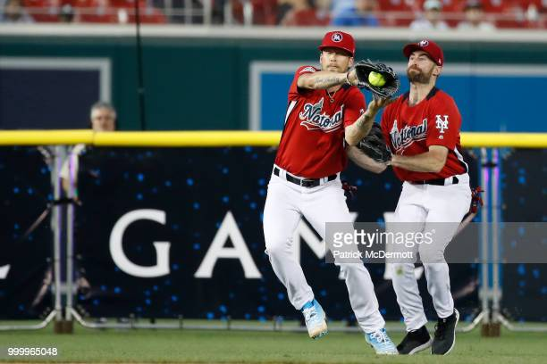 Brian Kelly catches a ball in front of Scott Rogowsky during the AllStar and Legends Celebrity Softball Game at Nationals Park on July 15 2018 in...