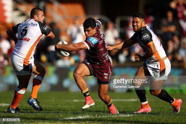 Brian Kelly of the Sea Eagles runs the ball during the round 19 NRL match between the Manly Sea Eagles and the Wests Tigers at Lottoland on July 16...
