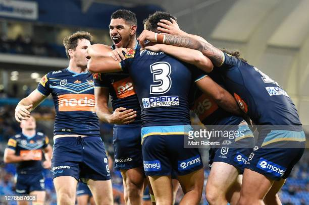 Brian Kelly of the Titans celebrates with his team mates after scoring a try during the round 20 NRL match between the Gold Coast Titans and the...