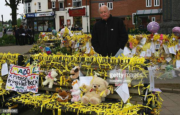 Brian Kennedy the great uncle of missing child Madeleine McCann stands amongst the messages of support at the War memorial in Rothley Village Centre...