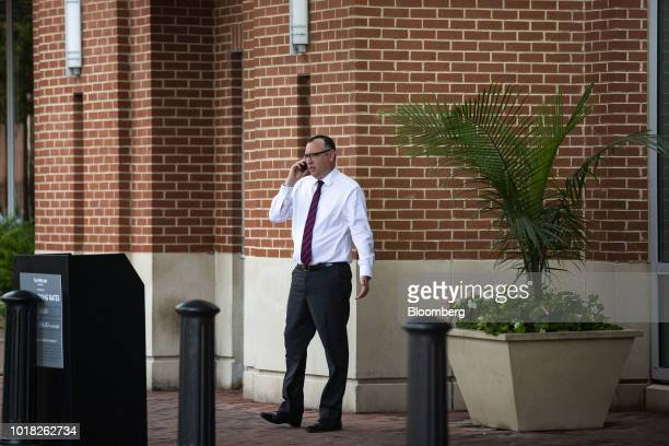 Brian Ketcham lawyer for former Donald Trump Campaign Manager Paul Manafort speaks on the mobile device across the street from District Court in...