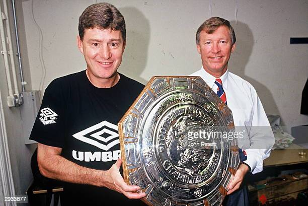 Brian Kidd and Sir Alex Ferguson celebrate in the dressing room after the Arsenal v Manchester United Charity Shield match at Wembley Stadium London...