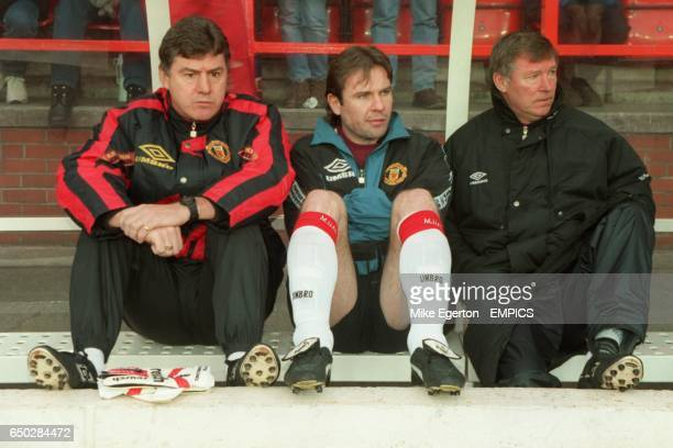 Brian Kidd Brian McClair and Alex Ferguson watch the match from the dug out