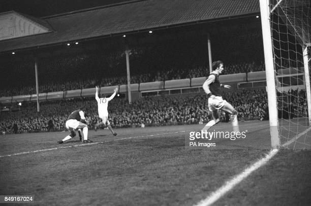 Brian Kidd evades Aston Villa's goalkeeper John Dunne on the ground and fullback Keith Bradley right to score Manchester United's first goal against...