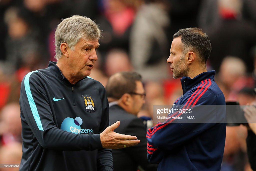 Brian Kidd joint assistant manager of Manchester City and Ryan Giggs assistant manager of Manchester United prior to the Barclays Premier League match between Manchester United and Manchester City at Old Trafford on October 25, 2015 in Manchester, England.