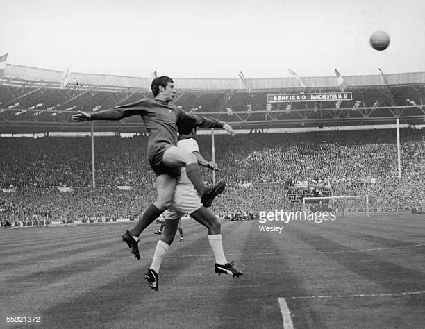 Brian Kidd left of Manchester United in a heading duel with Cruz of Benfica during the the European Cup final at Wembley 29th May 1968 Manchester...