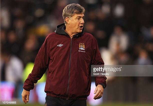 Brian Kidd Manchester City's assistant manager looks on ahead of the Barclays Premier League match between Fulham and Manchester City at Craven...