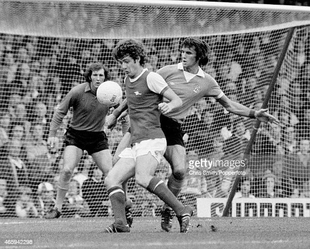 Brian Kidd of Arsenal and Dave Watson of Manchester City in action during the Arsenal v Manchester City Division One football match at Highbury...