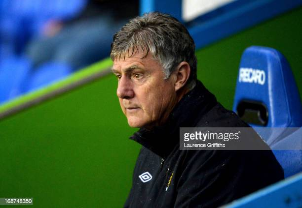 Brian Kidd of Manchester City looks on during the Barclays Premier League match between Reading and Manchester City at the Madejski Stadium on May 14...
