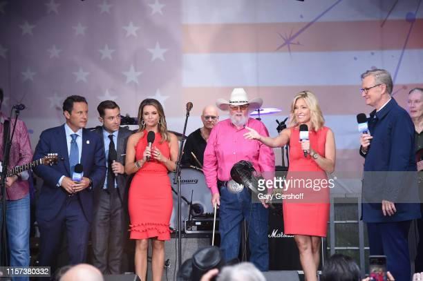 Brian Kilmeade Adam Klotz Jillian Mele Charlie Daniels Ainsley Earhardt and Steve Doocy seen onstage during FOX News Channel's FOX Friends...