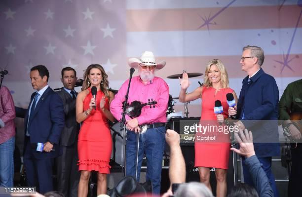 R Brian Kilmeade Adam Klotz Jillian Mele Charlie Daniels Ainsley Earhardt and Steve Doocy seen onstage during FOX News Channel's FOX Friends...