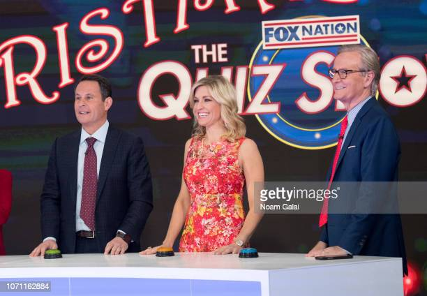 Brian Kilmeade Ainsley Earhardt and Steve Doocy are seen on the set of FOX Friends at FOX Studios on December 10 2018 in New York City