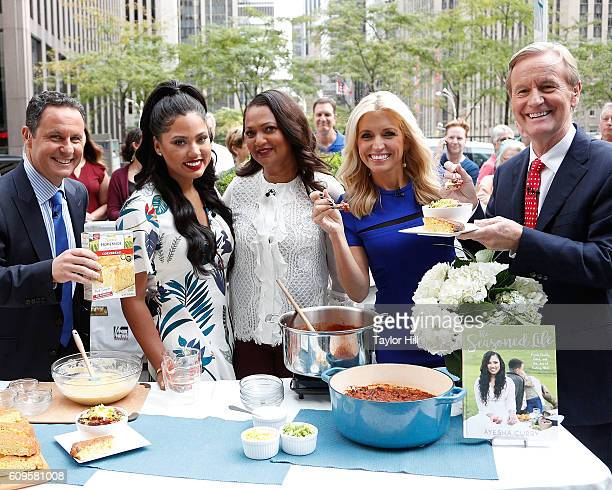 Brian Kilmeade Ayesha Curry Carol Alexander Ainsley Earhardt and Steve Doocy enjoy a chili cooking session on Fox and Friends at FOX Studios on...