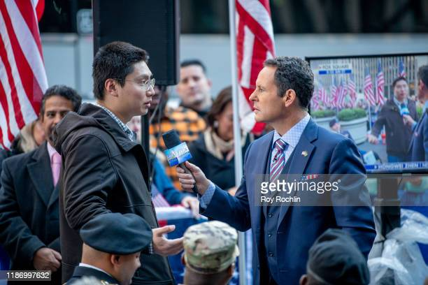 """Brian Kilmeade interviews a new citizens during the """"Fox & Friends"""" naturalization ceremony for Veterans Day at Fox News Channel Studios on November..."""