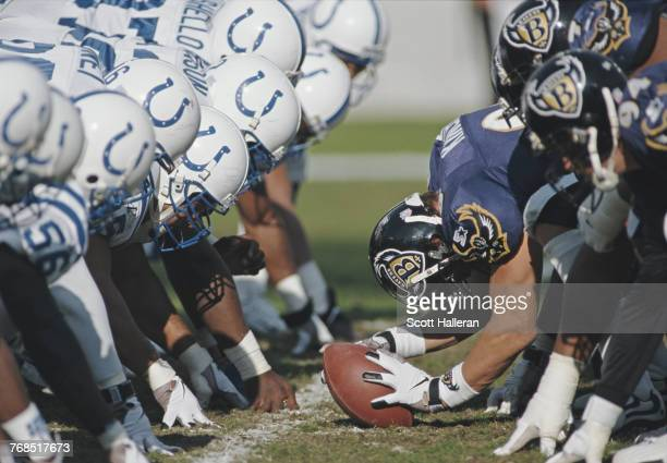 Brian Kinchen Long Snapper for the Baltimore Ravens prepares to snap the ball on the line of scrimmage during the American Football Conference...