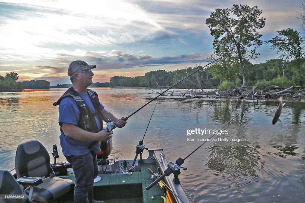 Brian Klawitter prepares to cast a line baited with a sucker one evening last week on the Mississppi River between Red Wing, Minn., and Hager City, Wis. Suckers are largely used to attract flathead catfish, not channel catfish. : News Photo