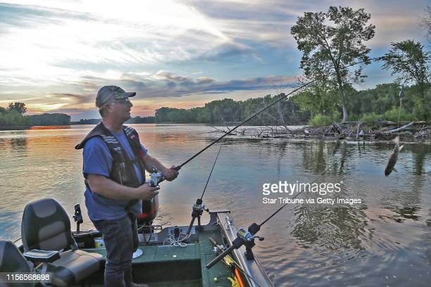 Brian Klawitter prepares to cast a line baited with a sucker one evening last week on the Mississppi River between Red Wing Minn and Hager City Wis...