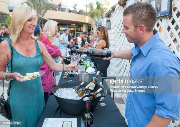 Brian Koebli right pours samples of wine from South Coast Winery during the 4th Annual Kaleidoscope Wines and Wishes event in Mission Viejo Proceeds...