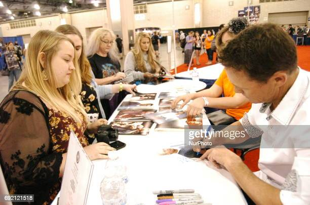 Brian Krause signs autographs for Charmed fans at Wizard World Comic Con in Philadelphia PA on June 2 2017