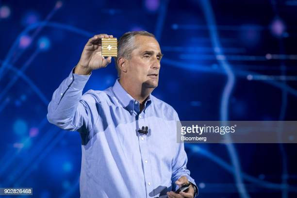 Brian Krzanich chief executive officer of Intel Corp holds up a 49qubit superconducting quantum test chip named 'Tangle Lake' while speaking during a...
