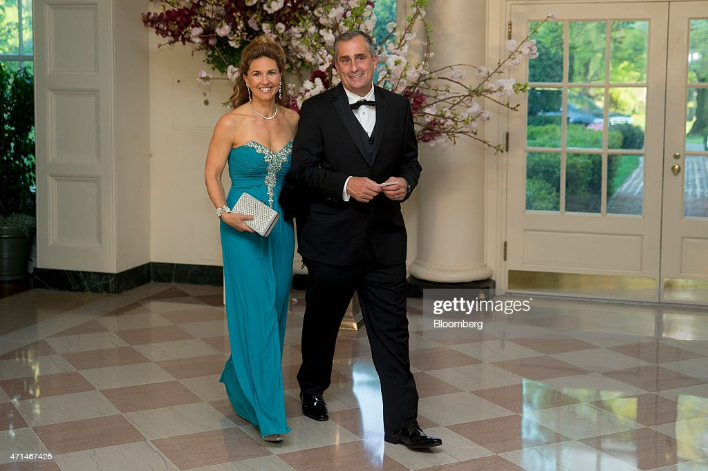 Brian Krzanich, chief executive officer of Intel Corp., right, and Brandee Krzanich arrive at a state dinner hosted by U.S. President Barack Obama and U.S. First Lady Michelle Obama in honor of Japan's Prime Minister Shinzo Abe at the White House in Washington, D.C., U.S., on Tuesday, April 28, 2015. Prime Minister Shinzo Abe goes before the U.S. Congress on Wednesday to present Japan as a stalwart ally that's willing to play a bigger military role in Asia, a message likely to be embraced in Washington and greeted with suspicion in Seoul and Beijing. Photographer: Andrew Harrer/Bloomberg via Getty Images