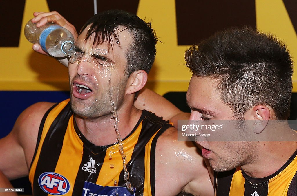 Brian Lake (L) of the Hawks celebrates the win with Jack Gunston who pours water over him during the round five AFL match between the Hawthorn Hawks and the North Melbourne Kangaroos at Melbourne Cricket Ground on April 28, 2013 in Melbourne, Australia.