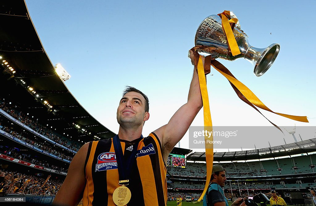 Brian Lake of the Hawks celebrates with the Premeirship Cup during the 2014 AFL Grand Final match between the Sydney Swans and the Hawthorn Hawks at Melbourne Cricket Ground on September 27, 2014 in Melbourne, Australia.