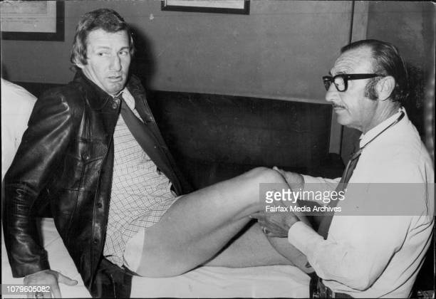 Brian Langlands captain of the NSW Laegues team has his knee checked by the team doctor Dr Len Greenberg during a club medical last night Dr said his...