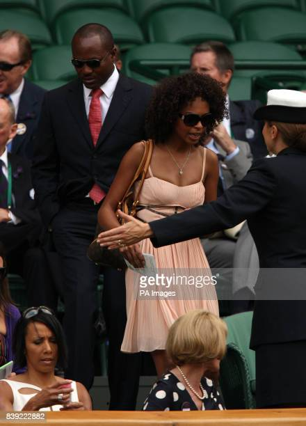 Brian Lara and Susan Gossage are shown their seats in the Royal Box on Centre Court during Day Six of the 2010 Wimbledon Championships at the All...