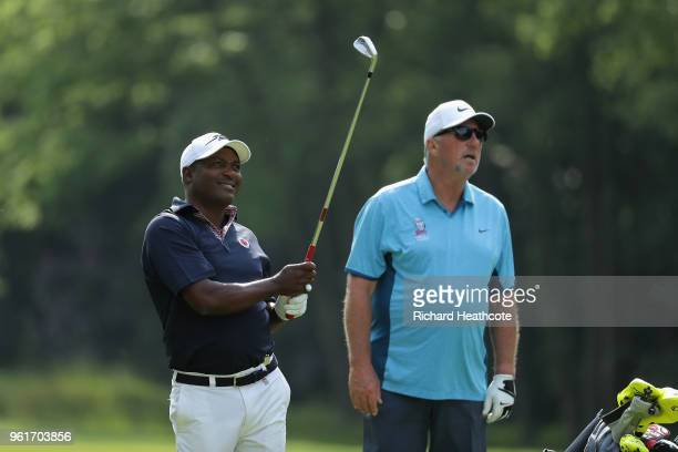 Brian Lara hits an approach watched by Ian Botham during the Pro Am for the BMW PGA Championship at Wentworth on May 23, 2018 in Virginia Water,...